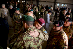 Third Place | News Photo Story Andrew Craft, The Fayetteville ObserverLt. Gen. Joseph Anderson hugs a member of the Afghan National Army as he says his goodbyes after the International Security Assistance Force Joint Command and 18th Airborne Corps Colors Lowering and Casing Ceremony, Monday, Dec. 8, 2014, at the Kabul Afghanistan International Airport. The 18th Airborne Corps officially ended its mission and the mission of International Security Assistance Force Joint Command in Afghanistan. They lowered the ISAF Joint Command flag, marking the dissolution of the special headquarters formed during the troop surge of 2009.