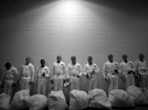 Honorable Mention | News Photo Story Al Drago, Elon UniversityProspective plebes stand in line after receiving their gear and before they learn how to salute during Induction Day at the U.S. Naval Academy, Tuesday, July 1, 2014, in Annapolis, Md.