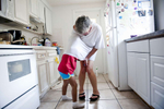 First Place | Feature Photo Story Carolyn Van Houten, UNC Chapel HillNevaeh tries to tickle Mary by climbing underneath her shirt in Mary\'s kitchen.  Despite the years of personal and financial struggle that raising her two grandchildren has put on her, she said,  \{quote}My life without Nevaeh and Kyle would be a sentence to me.  It would be like somebody would put me in prison and take the only thing I loved away.\{quote}