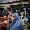 Third Place | Feature Photo StoryAndrew Craft, The Fayetteville ObserverA woman stares at U.S. soldiers as they make their way through a crowded market May 5, 2014, in Kabul, Afghanistan.