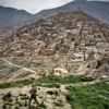 Third Place | Feature Photo StoryAndrew Craft, The Fayetteville ObserverHomes cover a hillside as a U.S. soldier walks the perimeter at Camp Bala Hissar in Kabul, Afghanistan.