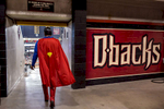 First Place | Sports Photo Story Ray Whitehouse, UNC Chapel HillA man dressed as superman walks around Chase Field in Phoenix, AZ, occasionally stopping to give fans high fives and take pictures.
