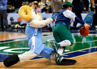 Third Place | Sports Photo StoryJerry Wolford, News & RecordUNC\'s Rameses mascot trips Notre Dame\'s leprechaun mascot, Johnny Romano, as the mascots from all the ACC schools play a short game against each other.
