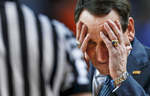 Third Place | Sports Photo StoryJerry Wolford, News & RecordHead coach Mike Krzyzewski holds his head as he walks toward official Tim Nester to question a call late in the game with Virginia leading. Virginia defeated Duke 72-63.