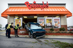 Photographer of the Year: Runner UPAndrew Craft, The Fayetteville ObserverA car rests in the front of Bojangles restaurant after speeding out of control Tuesday, March 18, 2014, in Hope Mills, N.C.
