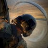 Photographer of the Year: Runner UPAndrew Craft, The Fayetteville ObserverSgt. Jeff Sidman, a medic with C Company, 3rd General Support Aviation Battalion, 82nd Combat Aviation Brigade,  looks out a bubble window of Black Hawk as they come in for a practice landing in a field near Bagram Airfield, Afghanistan.