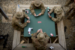 Photographer of the Year: Runner UPAndrew Craft, The Fayetteville ObserverParatroopers, from the 2nd Battalion, 504th Parachute Infantry Regiment, play a game of cards Wednesday, April 16, 2014, outside their barracks on Bagram Airfield. The soldiers, not far removed from a 2012 deployment marked by long patrols and near daily enemy attacks, expected no less when they flew to Afghanistan to serve as the country\'s Theater Response Force ahead of national elections. Once in the country, the soldiers prepared for the moment they would be called to action. On election day, they stood at the ready to fight the Taliban if needed. But the call never came.