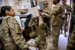 Photographer of the Year: Runner UPAndrew Craft, The Fayetteville ObserverSpc. Ivens Duperier, center, hands out mail to his fellow soldiers, from the 1st Battalion, 504th Parachute Infantry Regiment, Thursday, April 17, 2014, at Forward Operating Base Ghazni in Afghanistan. The soldiers will be the last troops at Forward Operating Base Ghazni before it is handed over to Afghan forces.