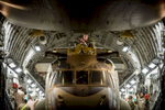 Photographer of the Year: Runner UPAndrew Craft, The Fayetteville ObserverA soldier sits atop a CH-47 Chinook as it is slowly pulled into the cargo hold of a C-17 Friday, Nov. 28, 2014, at Bagram Airfield for shipment back to the U.S. The soldiers have been sending a steady stream of helicopters, spare parts and other equipment out of Afghanistan as U.S. forces continue to draw down ahead of the changeover from Operation Enduring Freedom to Operation Resolute Support.