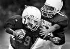 Sports Photographer of the Year Jerry Wolford, News & Record (Greensboro)Glenwood Recreation Center\'s Elijah Allen, 9, grimaces as he tackles running back, Jordan Mitchell, 8, during a preseason scrimmage at practice on Thursday, September 4, 2014.