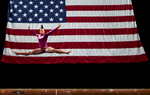 Sports Photographer of the Year Jerry Wolford, News & Record (Greensboro)USA\'s Elizabeth Price performs on the balance beam during the American Cup gymnastics competition on Saturday, March 1, 2014, in Greensboro, NC. Price won the women\'s overall title.
