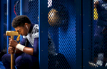 Sports Photographer of the Year Jerry Wolford, News & Record (Greensboro)Reidsville\'s defensive lineman Denzel Myers contemplates the night\'s game in the locker room before his game on Friday, November 28, 2014, in Reidsville, N.C.