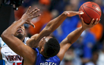 Sports Photographer of the Year Jerry Wolford, News & Record (Greensboro)Virginia forward Akil Mitchell (25) blocks the shot of Duke forward Jabari Parker (1) during the championship game.