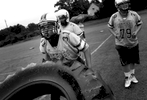 Sports Photographer of the Year: Runner UpScott Muthersbaugh, Perfecta VisualsCummings High School football player Mark Slade struggles to flip a truck tire during the first day of practice at the high school on Saturday, August 2, 2014.