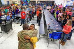 First Place | General NewsGerry Melendez, The StateIn a surprise visit, Army Sgt. Steve Mims hugs his son Jorden, 8, at Herbert A Wood Elementary School in West Columbia after coming home from his deployment, January 30, 2014.