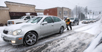Second Place | General  NewsJerry Wolford, News & RecordComments from the judges: There were lots of snow photos, but none that hand the combination of elements that included someone pushing a car, with a long line of motorists backed up behind. Those elements and the way they were composed made this photo a winner.Police Department officer A.R. Schoonmaker pushes a car up the  hill along the 600 block of West Market St. during the heavy snow in the downtown area. The snow blanketed the streets just before the 5 o'clock rush.