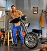 First Place | Multiple PhotosCindy Burnham, The Fayetteville ObserverSenior Pastor JD Tew delivers his sermon from a pulpit built from a motorcycle wheel and handlebars.