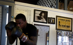 Second Place | Multiple PhotosGrace Beaham, The Post and CourierA workout list and memorabilia cover the walls at the Charleston Boxing Club including Meggett\'s fight poster against Muhammad Ali on King Street Wednesday February 5, 2014 where Ira Hughes works out.