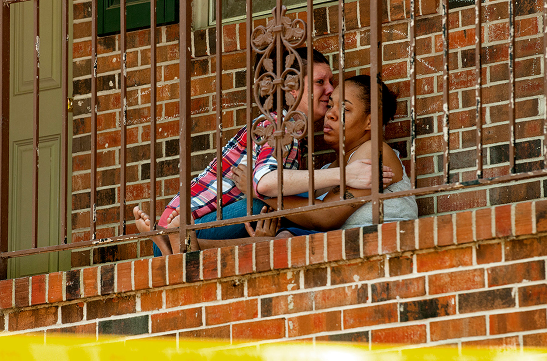 First Place | Spot NewsCindy Burnham, The Fayetteville ObserverJudge's Comments: Good sense of scene and emotion between people. Would like the caption to say who is who in the frame.A neighbor comforts Carla Jones after police and medics were called to the Georgetown Apartments on Tallywood Drive about noon after receiving a report that a child was not responsive.