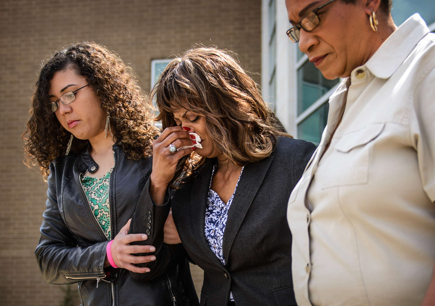 Second Place | General  NewsJames Robinson, The Fayetteville ObserverJudge's Comments: This was probably a difficult situation to get. Nice emotion and good that it was shot from a lower angle because you can see the faces well.Danielle Locklear's grandmother, center, Darlene Heegel leaves the Cumberland County Detention Center after the first appearance of Je'Michael Devanair Malloy and Dominic Tayvon who are charged with the second degree murder of Danielle Locklear.