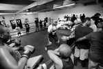 First Place | Multiple PhotosMykal McEldowney, The Greenville NewsBoxers spar inside the old ring at the Club. Members of the club stand around the ring and give support to their comrades.