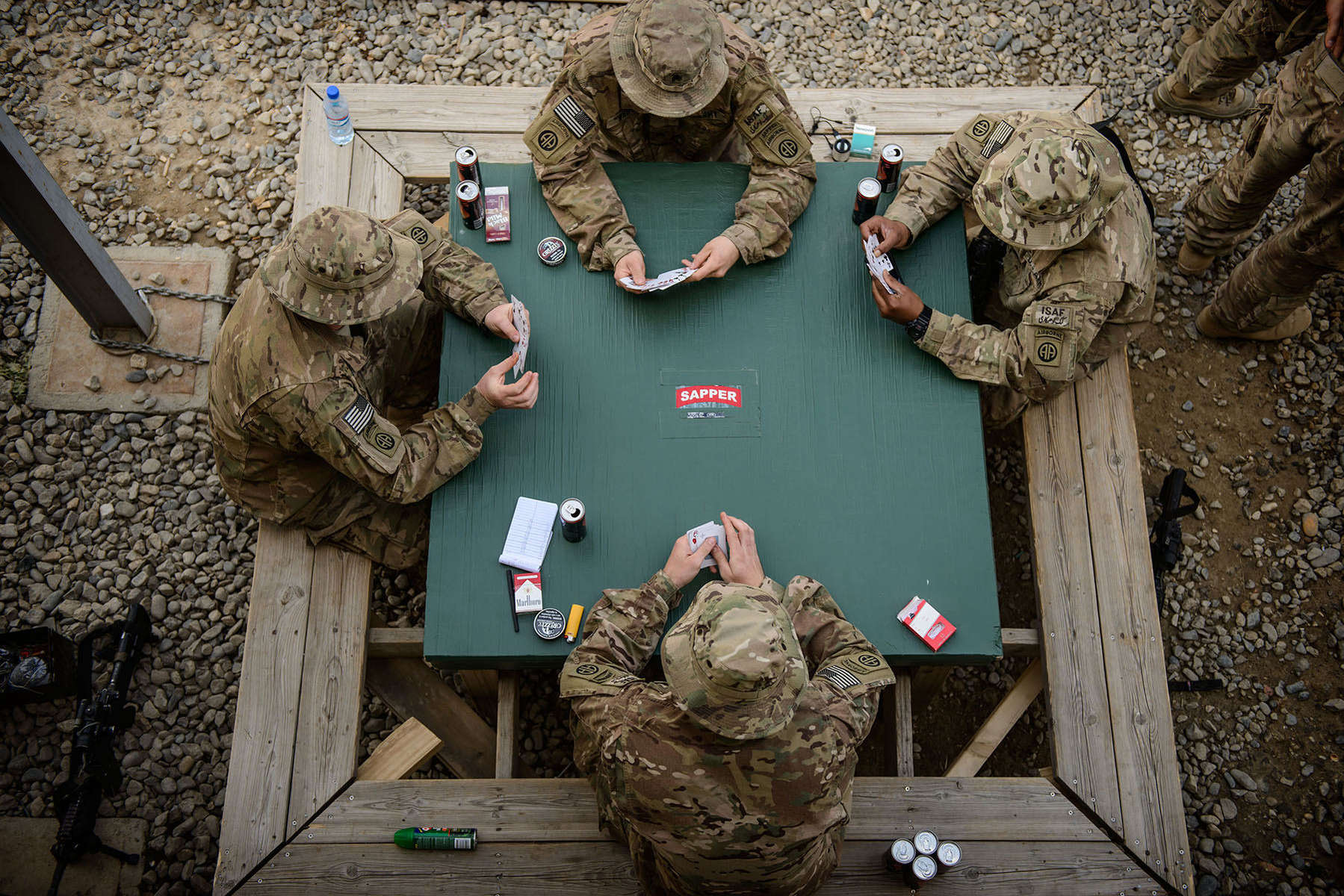 Second Place | Multiple PhotosAndrew Craft, The Fayetteville ObserverParatroopers, from the 2nd Battalion, 504th Parachute Infantry Regiment, play a game of cards Wednesday, April 16, 2014, outside their barracks on Bagram Airfield. Unlike other units, their mission doesn't involve a partnership with Afghan troops. They don't train, advise or assist. Instead, they stand on alert, ready to lend a hand to coalition or Afghan troops under attack. But since arriving in late February, the deployment has been quiet. Especially compared with the 2012 deployment to Ghazni province, where paratroopers lived in sparse conditions while undertaking the last major clearing operation of the war by U.S. troops.