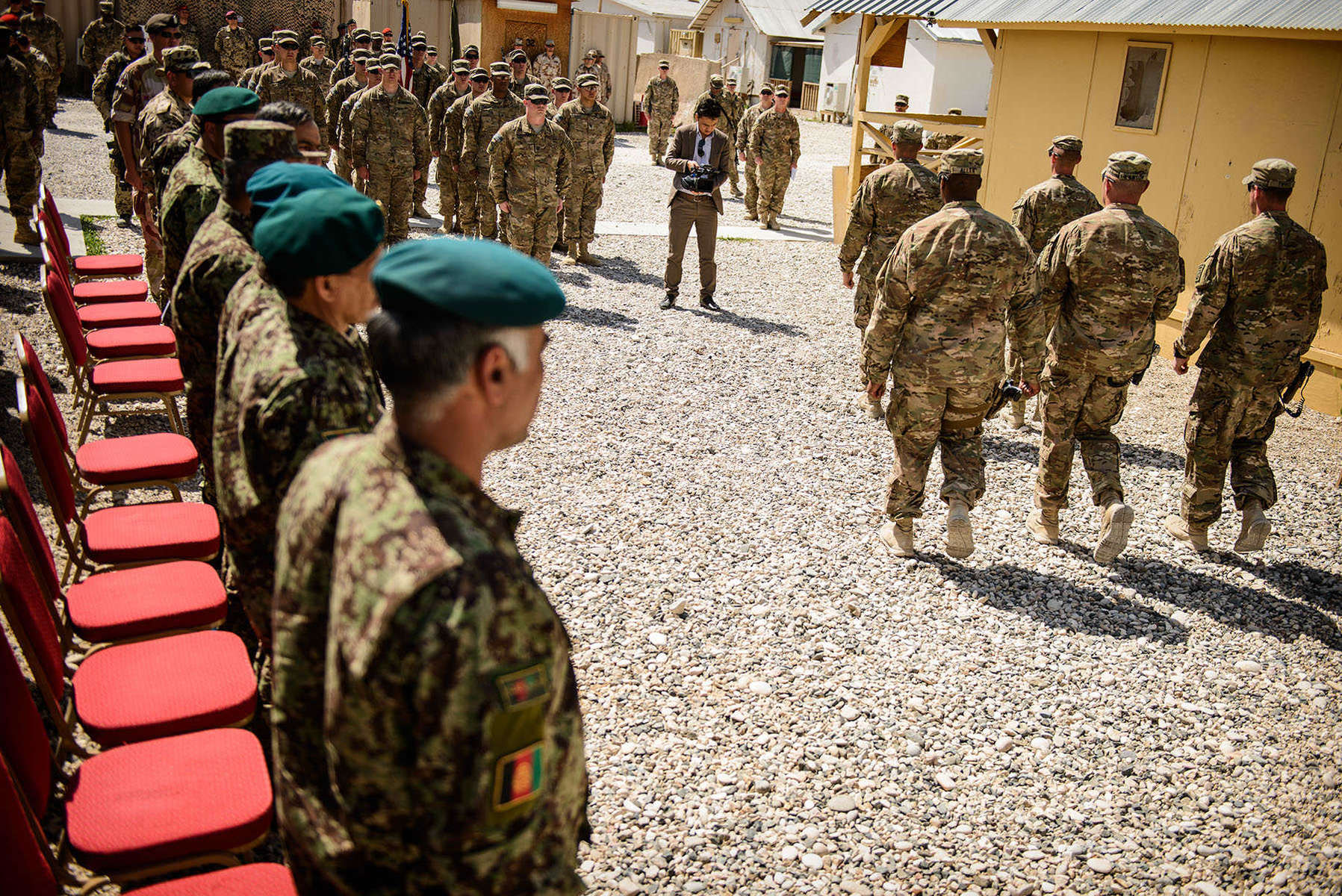 Second Place | Multiple PhotosAndrew Craft, The Fayetteville ObserverParatroopers with B Company, 2nd Battalion, 508th Parachute Infantry Regiment, walk away after taking down the last American flag to fly over Camp Mike Spann Sunday, April 27, 2014, during the ceremony that hands over control of the camp to the Afghan National Army. Afghan Col. M. Ayel Rahimi, head of operations for the 209th Corps, said the transfer of Spann was an important day for the Afghan army. {quote}We will try to keep it - to improve it,{quote} he said.