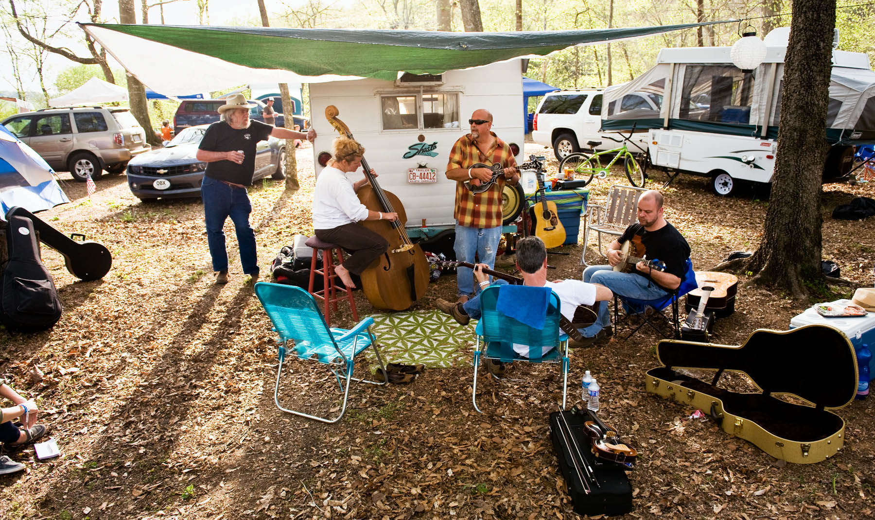 Third Place | Multiple PhotosAndrew Dye, Winston-Salem JournalMusician Tuck {quote}Coyote{quote} Carson listens as, from left, Sherri and Mark Criminger, Dave Paolucci and Chris Coyier jam on Thursday, April 24, 2014 at the Rivers Edge Campground in Wilkesboro, N.C.