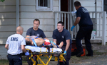 Third Place | Spot NewsScott Muthersbaugh, Burlington Times-NewsMembers of Alamance County EMS and Burlington Fire wheel a victim of a shooting to a waiting ambulance at 418 Piedmont Way in Burlington Friday afternoon.