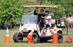 Honorable Mention I General NewsAdam Jennings, Rocky Mount TelegramRashawn Ballard, 15, right, participates in a Fatal Vision Driving Course with Rocky Mount Police Cpl. D.E. Bowers on Thursday, June 26, 2014 at the City Soccer Field.