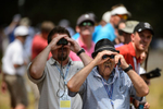 Honorable Mention I FeatureAndrew Craft, The Fayetteville ObserverRussell Toutant, right, and Jerome Garrison, both of Fayetteville, use binoculars to get a better view Saturday, June 14, 2014, during the third round of play at the U.S. Open golf tournament in Pinehurst, N.C.
