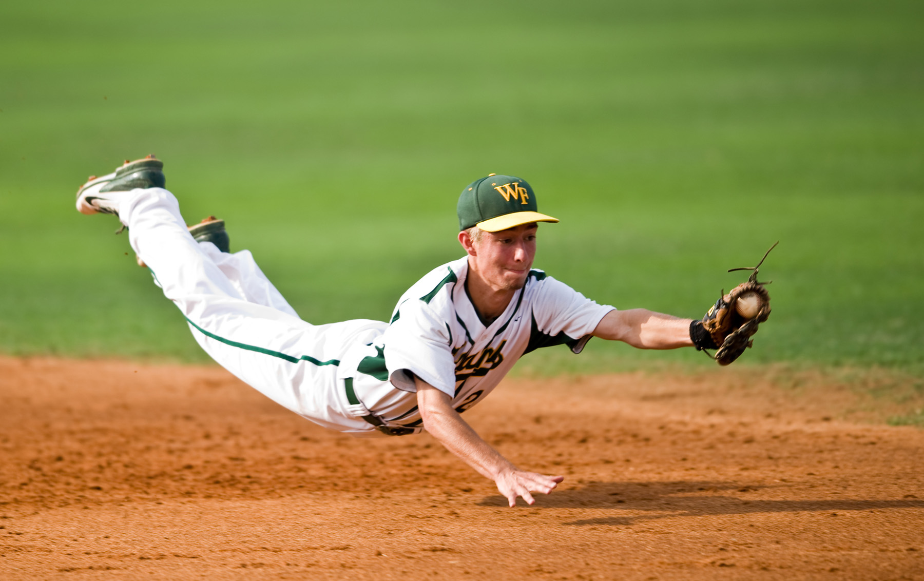 First Place | SportsAndrew Dye, Winston-Salem JournalWest Forsyth High School senior second baseman Jarrett Corder (2) makes a diving catch off of a hit from Richmond High School senior second baseman Mike Rush (1) on Friday, June 6, 2014 in Greensboro, N.C. Rush was tagged out at first to end the top of the fourth inning.