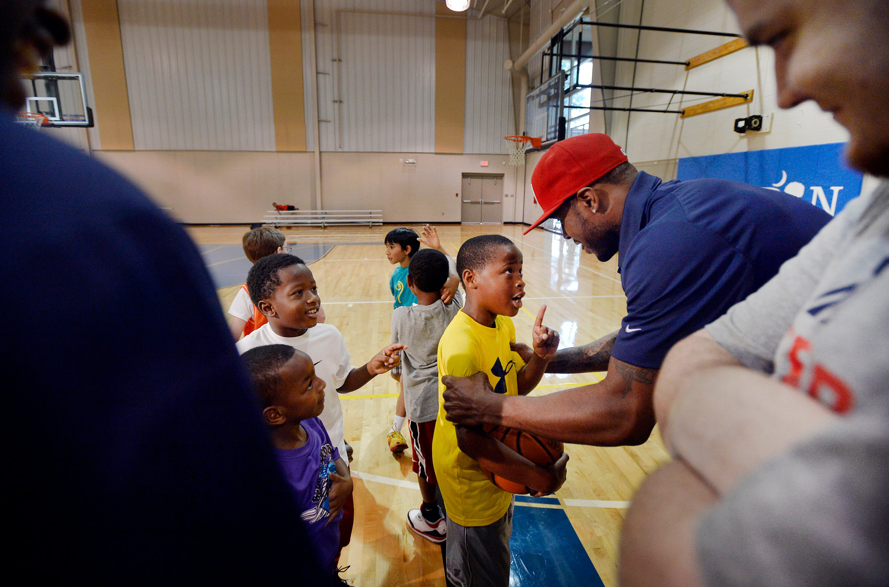 Third Place | SportsMykal McEldowney, The Greenville NewsWashington Wizards forward and former Clemson standout Trevor Booker gets an earful from a camper during the Trevor Booker Basketball Camp at the Mauldin Recreation Center on June 9, 2014. {quote}You need to be tough under the basket,{quote} said Booker. {quote}I make shots, I don't rebound,{quote} the camper replied.