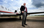 Second Place | PortraitMykal McEldowney, The Greenville NewsSteve Townes, president and CEO of Louis Berger Services, poses for a portrait in front of a jet at Stevens Aviation facility at GSP on Friday, June 13, 2014.