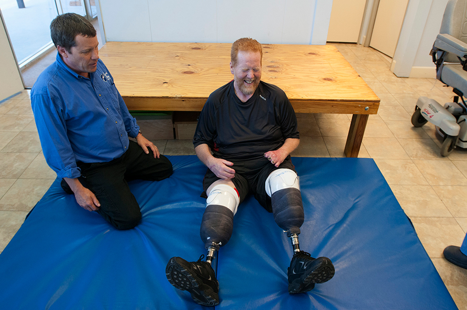 Third Place | Multiple PhotosMike Spencer, The Wilmington Star-NewsPhysical Therapist Tim Marahrens looks on as Lee Spearman laughs while trying to get up from the floor at First Step Therapy in Wilmington, N.C., April 3, 2014. Lee Spearman was hospitalized in December of 2013 with an infection that was ravaging his body and almost took his life and resulted in having both of his legs amputated below the knee and all the fingers on his left hand.