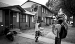 Third Place | Multiple PhotosJerry Wolford, News & RecordThe judges really liked the attention to detail in the tuba story…we would have liked to see more of this story.Tyreese Milton dances in front of Ricky Battle Jr.'s apartment.