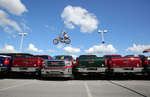 Second Place | General  NewsAdam Jennings, Rocky Mount TelegramMotorcycle stuntman Bubba Blackwell jumps over a line of 10 GMC Sierra trucks on Friday, Sept. 5, 2014, during a motorcycle stunt show at Davenport Autopark as part of the North Carolina Harley Owners Group Rally.
