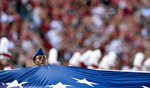 Second Place | FeatureMykal McEldowney, The Greenville NewsAn ROTC student helps hold the large American flag during the national anthem before the USC Gamecocks face the East Carolina Pirates at Williams-Brice Stadium in Columbia on Saturday, September 6, 2014.