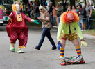Second Place | FeatureMark Dolejs, Daily DispatchJudges Comments: Funny moment and a clean composition. Donnie Phillips, who is Flash the clown, looses his pants while dancing in the Shrine parade at the Masonic Home for Children in Oxford.