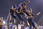 Second Place | SportsKen Ruinard, Anderson Independent MailJudges Comments: Photographer uses low angle and rhythm. Wren's Kelly Bryant, middle, celebrates his touchdown with teammates Bailey Rogers (4), left, and A.J. Barton (51), right, against Walhalla during the first quarter at Wren High School in Piedmont.