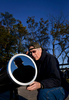 First Place | Multiple PhotosLauren Carroll, Winston-Salem JournalBruce Thompson of Clemmons sets up a 10 inch Dob telescope to watch a partial solar eclipse Thursday, October 23, 2014. The Forsyth Astronomical Society organized a viewing party at Pilot Mountain State Park. Bruce Mellin of Winston-Salem is reflected in the mirror.