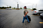 Second Place | Multiple PhotosMykal McEldowney, The Greenville NewsSteve Payne carries the last of his belongings across the Super Lodge lot as he prepares to move from the motel to a house on Friday, October 3, 2014. With help from the United Housing Connections' Restore A Home project, the Payne's are leaving a decade of homelessness behind them.