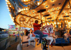 Third Place | Multiple PhotosAdam Jennings, Rocky Mount TelegramRakia Brinkley rides the carousel on Monday, Oct. 6, 2014, during the first night of the Rocky Mount Fair.