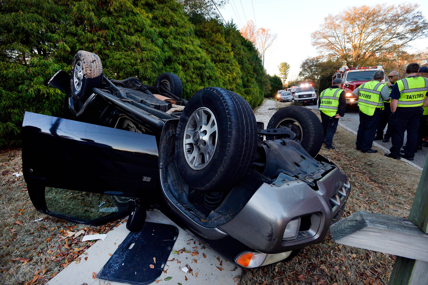 Third Place | Spot NewsMykal McEldowney, The Greenville NewsA car carrying four Eastside High School students overturned on Kimbrell Road in Taylors near the school on Friday, November 21, 2014.