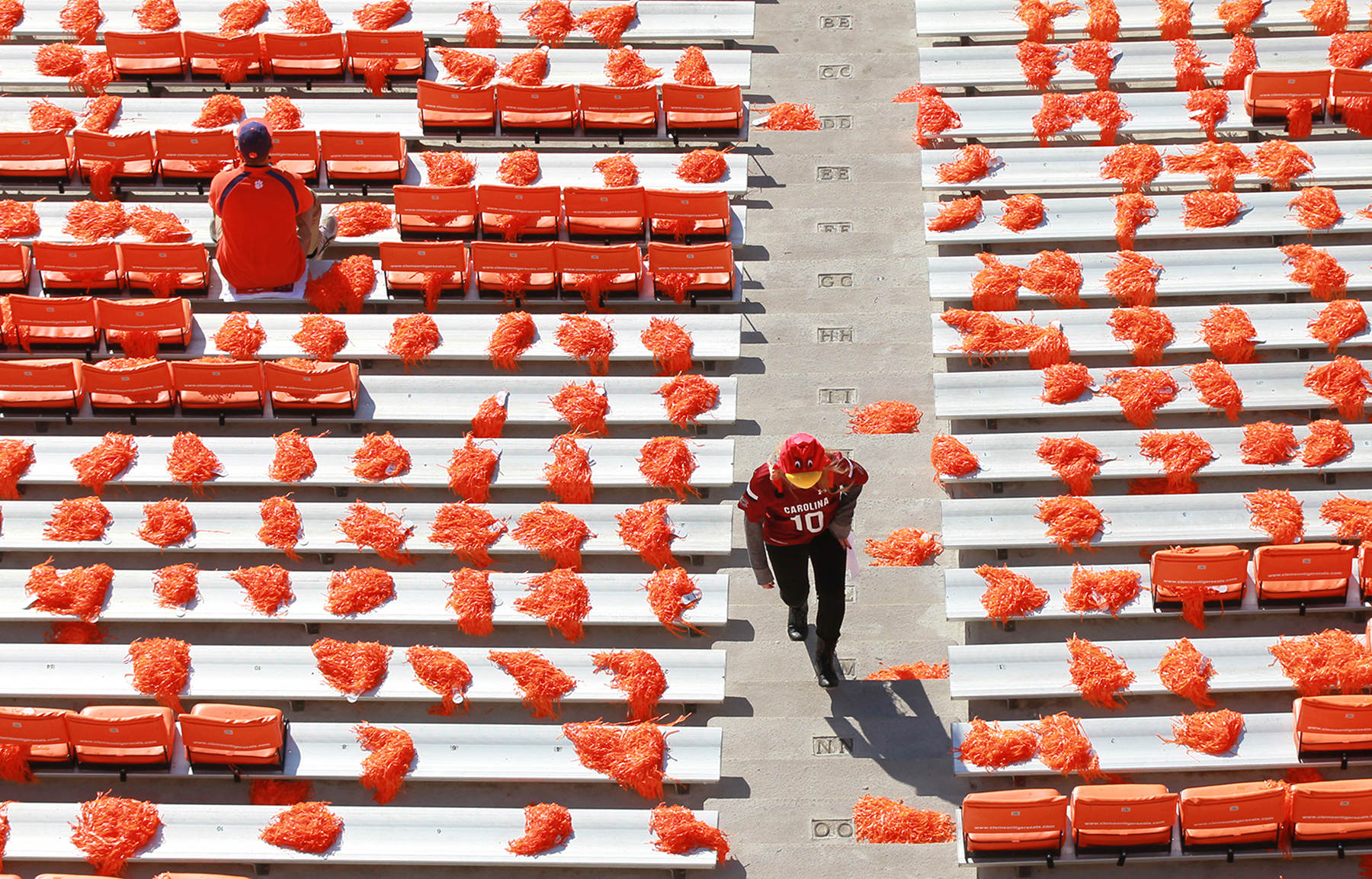 First Place | FeatureKen Ruinard, Anderson Independent MailA South Carolina football fan arrives early to Memorial Stadium, where one Clemson fan already found his seat. The sellout crowd of 84,000 is the norm for the state rivalry of over 100 years, so fans come early. {quote}Early bird{quote}
