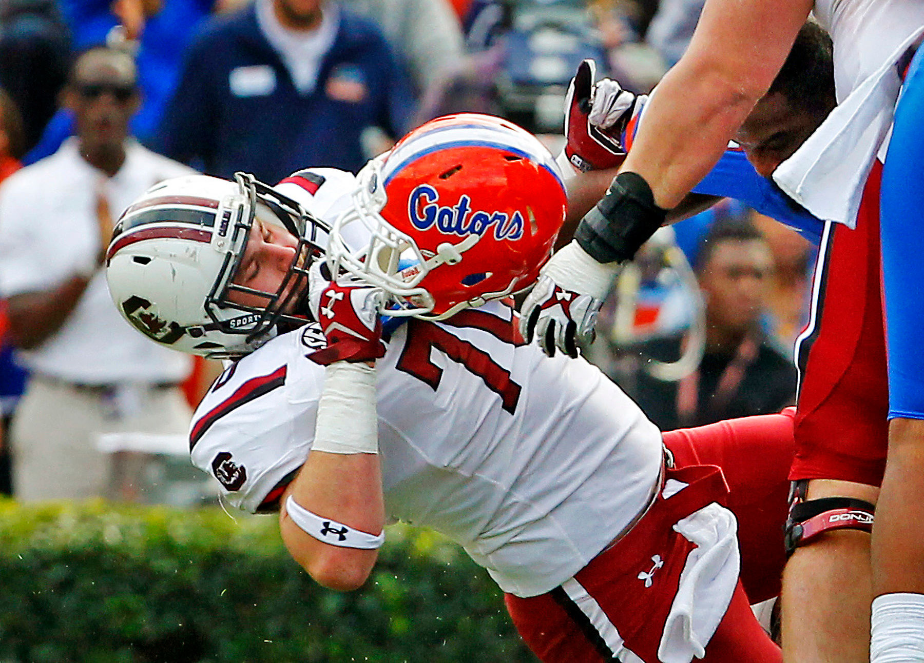 First Place | SportsGerry Melendez, The StateSouth Carolina Gamecocks center Alan Knott (70) rips the helmet off Florida Gators defensive lineman Darious Cummings (55) during a fourth quarter play at Ben Hill Griffin Stadium, in Gainesville, FL, Saturday, November 15, 2014.