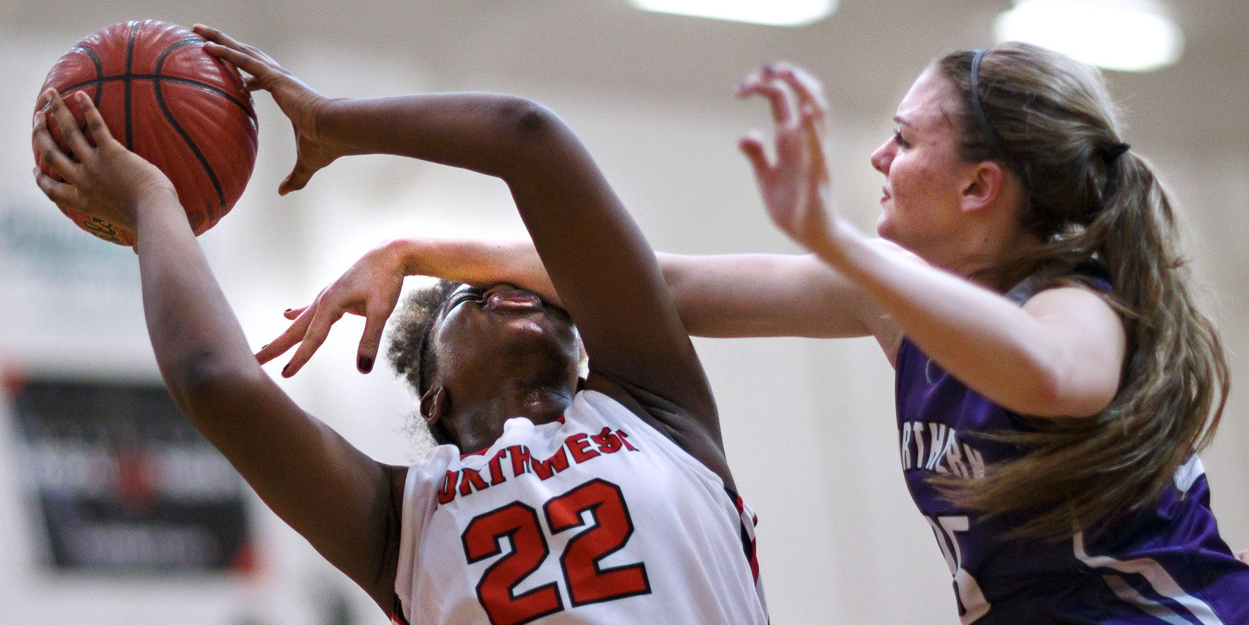 Honorable Mention I SportsJerry Wolford, News & RecordNorthern Guilford's Kasey Johnson hits Northwest Guilford's Bria Gibbs in the nose while trying to block a shot and is called for the foul. Non-conference girls basketball, Northern Guilford at Northwest Guilford on Tuesday, November 25, 2014.