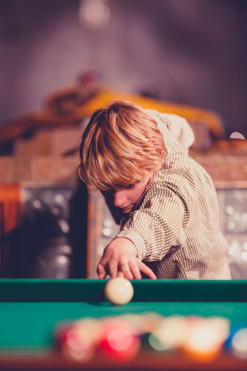 Third Place | PortraitCaleb Smallwood, Randolph Community CollegeConnor Olson eyes up his break for a game of 8-ball at Longshanks Billiards Hall, Greensboro, NC on Nov 23, 2014. Conner is the son of Danny Olsen who tends bar at Longshanks Biliards. Conner has taken an interest into billiards and comes up regularly for lessons by some of the local players.