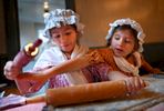 Second Place | Multiple PhotosJerry Wolford, News & RecordCaroline Perez, 8, and her sisterMaggie Perez, 5, get crossed up as Maggie reaches for her rolling pin as the two make Moravian cookies at the First Moravian Church's annual Candle Tea on Friday, December 5, 2014, in Greensboro, N.C. First Moravian Church's annual Candle Tea was free and open to the public on Friday and Saturday. The event presented the experience of an old-fashioned, 18th-century Moravian Christmas with snacks, tea, and old fashioned crafts.