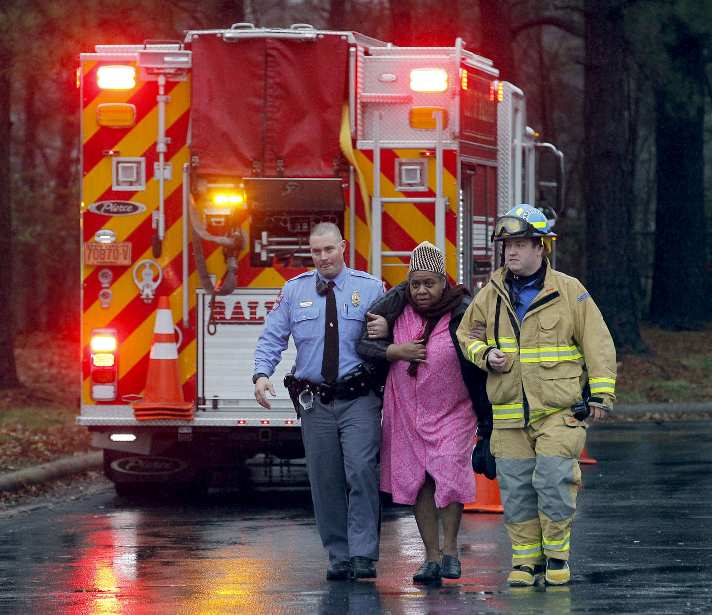 First Place | Spot NewsChris Steward, News & ObserverA Raleigh police officer and a paramedic offer assistance as they evacuate a woman after fire broke out at the Raleigh Inn.